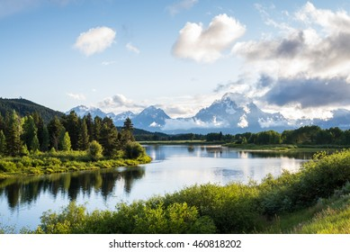 The scenic Oxbow Bend overlook in the Grand Teton National Park in Wyoming as the snake river winds around the bend and the tetons in the background.