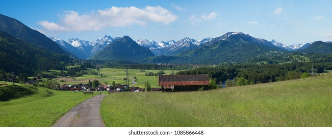 scenic panorama allgau landscape with view to spa town rubi and mountains oberstdorf area in early summer