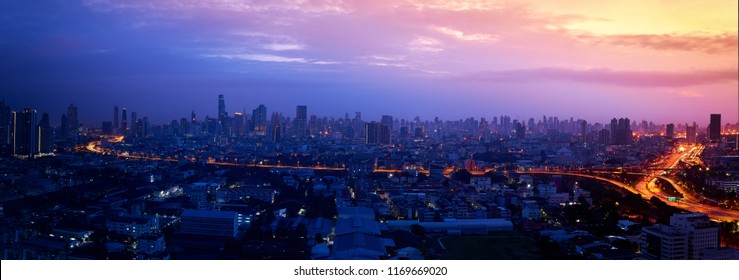scenic of panorama of cityscape with sunrise skyline and expressway light in metropolis