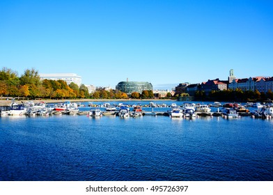 Scenic panorama of colorful autumn and sea pier in Hakaniemi district in Helsinki, Finland.