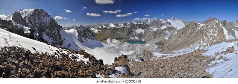 Scenic panorama of lake below highest mountain peaks in Ala Archa national park in Tian Shan mountain range in Kyrgyzstan