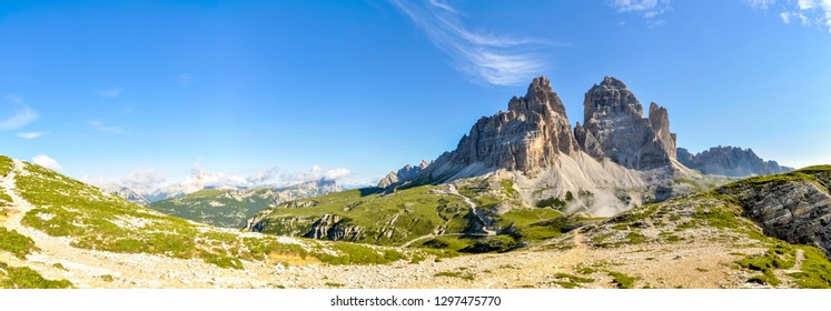 Scenic panorama of the majestic peaks of Italian Dolomites on sunny summer day.