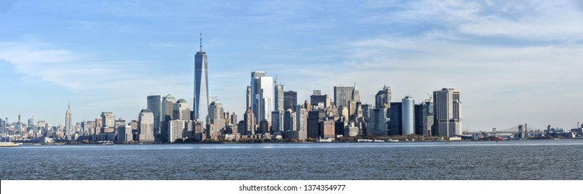 Scenic panorama of Manhattan Island--New York City on a sunny, autumn day.  Upper New York Bay and the Hudson River in the foreground.