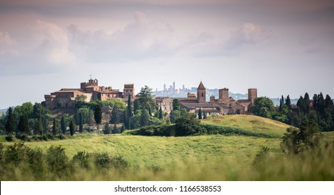 Scenic panorama of medieval village of Certaldo old town, Italy, with San Gimignano towers in the background, typical Italian and Tuscany countryside landscape