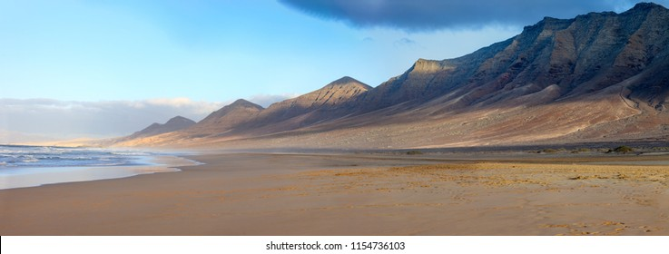 Scenic panorama of mountain landscape and Atlantic ocean in Canary Islands, Fuerteventura, Spain. Nature background