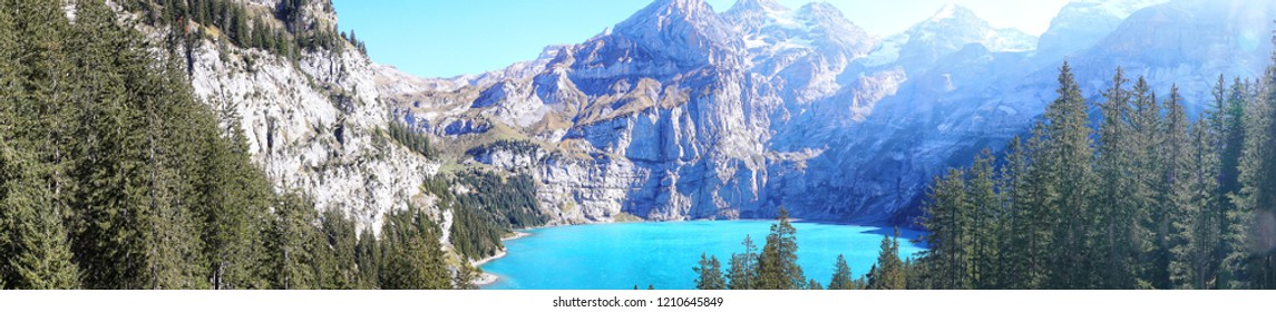 Scenic Panorama picture or postcard view of Oeschinensee lake,Wooden chalet and Swiss Alps, Beautiful outdoor scene in Berner Oberland,Kandersteg Switzerland.Vacation Holiday.