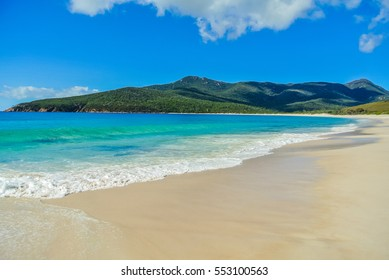 Scenic panorama of remote Australian beach with pristine white sand at Wineglass Bay, Freycinet National Park, Tasmania