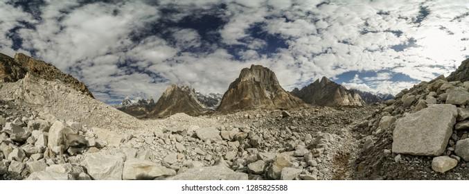 Scenic panorama with trekking trail on Baltoro Glacier in Karakoram Mountain Range, Pakistan.