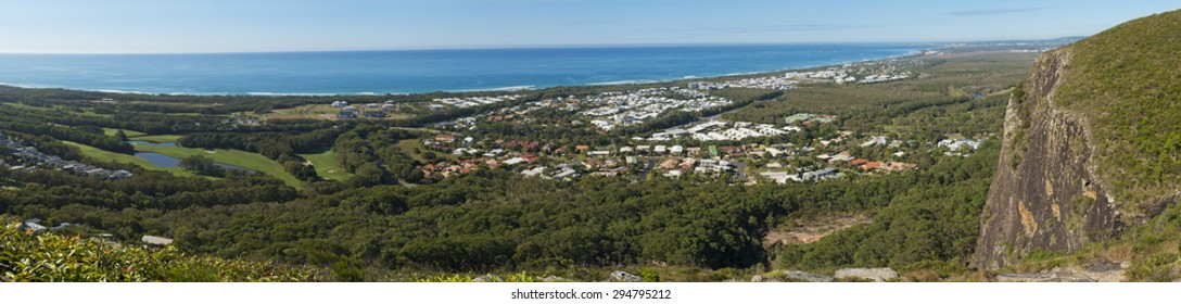 Scenic panorama view of Sunshine Coast from Mount Coolum. Blue skies with few clouds, Mudjimba and Moloolaba bay on can be seen on the horizon and the Coral Sea.