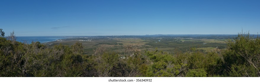 Scenic panorama view of Sunshine Coast from Mount Coolum. Blue skies with few clouds, Mudjimba and Moloolaba bay on left, Buderim and Glasshouse Mountains on middle and hinterland on right.