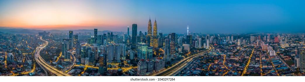 Scenic panoramic aerial view of Kuala Lumpur cityscape skyline, sunrise / sunset scene, Malaysia .