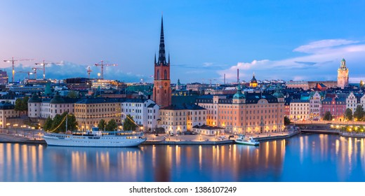 Scenic panoramic aerial view of Riddarholmen, Gamla Stan, in the Old Town in Stockholm at night, capital of Sweden