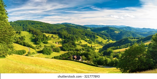 Scenic panoramic landscape: summer mountain valley with forests and fields in Germany, St. Ulrich, Black Forest