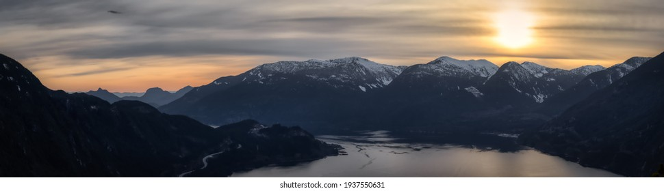 Scenic Panoramic Landscape view of the Beautiful Canadian Nature from the top of the Mountain during a colorful sunset. Taken in Squamish, North of Vancouver, British Columbia, Canada.