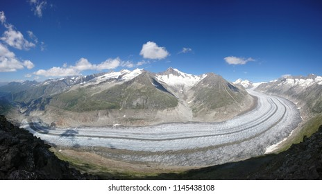Scenic panoramic picture of massive Aletschhorn overlooking mythical Aletsch Glacier viewed from the slopes of Eggishorn on a marvelous Summer afternoon - Wallis - Switzerland