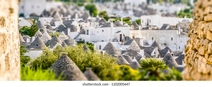 Scenic panoramic view of Alberobello town and its typical trulli buildings, Apulia, Italy. Tilt-shift effect applied