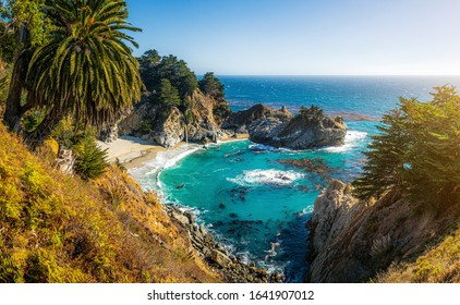 Scenic panoramic view of famous McWay Falls in scenic golden evening light at sunset on a beautiful sunny day with blue sky in summer, Julia Pfeiffer Burns State Park, Big Sur, California, USA