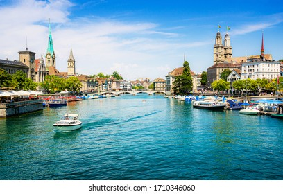 Scenic panoramic view of historic Zürich city center with famous Fraumünster and Grossmünster Church and river Limmat at Lake Zurich on a beautiful sunny day with blue sky in summer, Switzerland