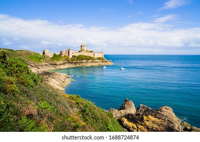 Scenic panoramic view of historic Fort-La-Latte castle on the famous Cote d'Emeraude with deep blue Atlantic sea near Cap Frehel on a beautiful sunny day in summer, Cotes-d'Armor, Brittany, France