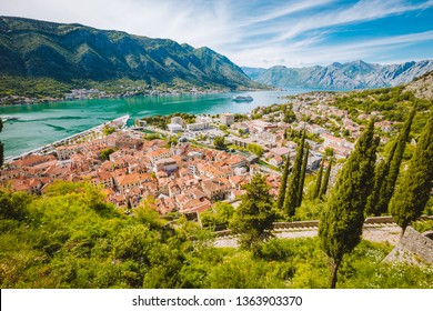 Scenic panoramic view of the historic town of Kotor with famous Bay of Kotor on a beautiful sunny day with blue sky and clouds, Montenegro, Balkans