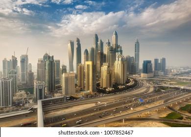 Scenic panoramic view of modern city. Aerial daytime skyline of Dubai Marina, UAE, with skyscrapers. Summer travel background.