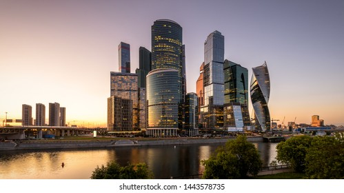 Scenic panoramic view of Moscow-City skyscrapers at sunset, Russia. Modern business district at Moskva river. Night panorama of new tall buildings. Moscow urban skyline with financial towers at dusk.