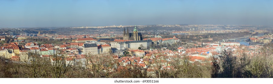 Scenic panoramic view of Prague from tower on Petrin hill towards Hradcany and Lesser Town districts in sunlight of winter afternoon, Czech Republic.