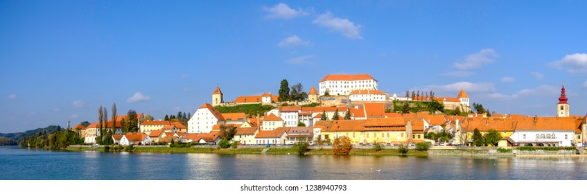 Scenic panoramic view of river Drava and castle on hill in old historic touristic town Ptuj in Slovenia