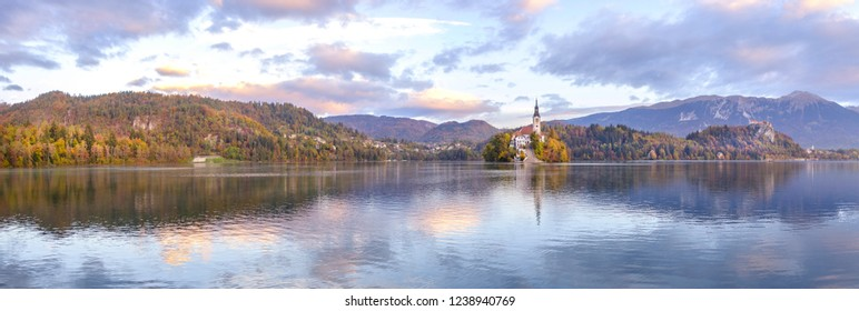 Scenic panoramic view of small island with church of the Assumption of Maria in center of lake Bled - the most popular hiking spot in Slovenia
