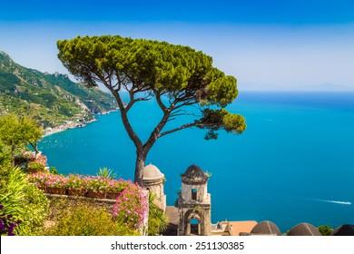 Scenic picture-postcard view of famous Amalfi Coast with Gulf of Salerno from Villa Rufolo gardens in Ravello, Campania, Italy