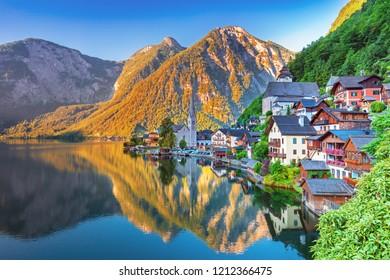 Scenic picture-postcard view of famous Hallstatt mountain village in the Austrian Alps at beautiful light in summer morning, Salzkammergut region, Hallstatt, Austria