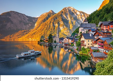 Scenic picture-postcard view of famous Hallstatt, UNESCO mountain village in the Austrian Alps at beautiful light in summer, Salzkammergut region, Hallstatt, Austria