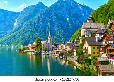 Scenic picture-postcard view of famous Hallstatt mountain village in the Austrian Alps. Beautiful light in summer, Salzkammergut region, Hallstatt, Austria.
