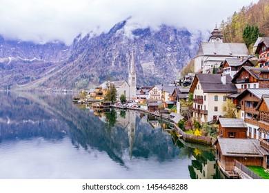 Scenic picture-postcard view of famous Hallstatt mountain village with Hallstaetter Lake in the Austrian Alps, region of Salzkammergut, Austria