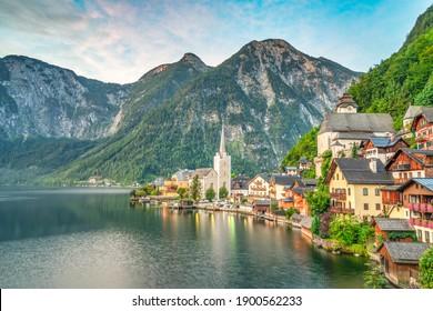Scenic picture-postcard view of famous Hallstatt mountain village in the Austrian Alps at beautiful light in summer, Salzkammergut region, Hallstatt, Austria