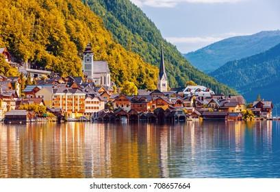 Scenic picture-postcard view of famous Hallstatt mountain village in the Austrian Alps at beautiful evening light at sunset in summer, Salzkammergut region, Hallstatt, Austria