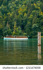 Scenic picture-postcard view of famous Königssee natural lake in Berchtesgadener Land district of the German state of Bavaria, near the Austrian border mountain village in the Austrian Alps.