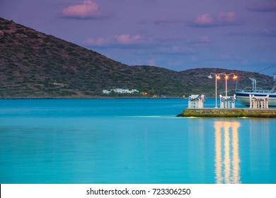 Scenic pier for romantic dinner on the sea at Elounda, Crete, Greece.