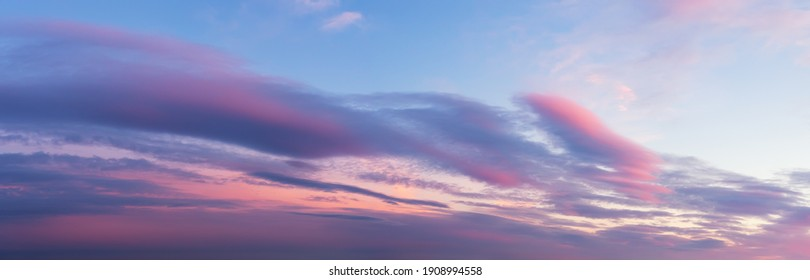 Scenic pink purple clouds against azure sky at sunset. Majestic vanilla sky panoramic shot. Beautiful pastel colored  evening skyscape. Paradise heaven. Beauty in nature.