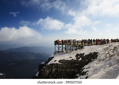 Scenic point on jade dragon snow mountain, Snow Mountain on the day a clear blue sky. Tourists are walking up snowy mountain, Jade dragon snow mount, Lijiang, yunnan, southern china, Stairs, walkways