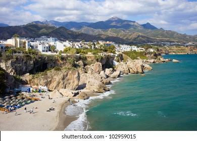 Scenic resort town of Nerja with small sandy beach on Costa del Sol by the Mediterranean Sea in Spain, southern Andalusia region, Malaga province.