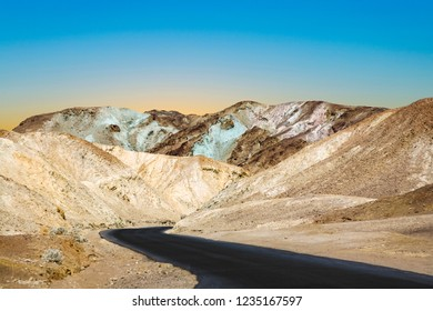 scenic road Artists Drive in Death valley, arount stones,hills  with colorful minerals, blinking colorful in the sun