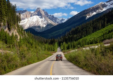 Scenic road in the Canadian Rockies during a vibrant sunny summer day. Taken in Yoho National Park, British Columbia, Canada.