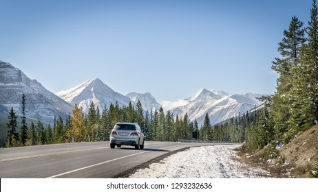 Scenic road in the Canadian Rockies Mountains during a sunny winter day, Banff, Canada
