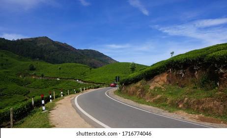 Scenic road in green tea plantations, Munnar, Kerala state, India.