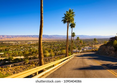 Scenic road leading to Palm Springs in California, USA. It is a desert resort city in Riverside County within the Coachella Valley.