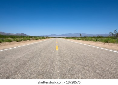 Scenic road in the Mojave park at summer day