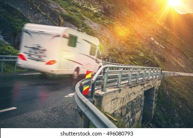 Scenic Road Motorhome Trip. Motorcoach RV Camper on the Scenic Mountain Road.