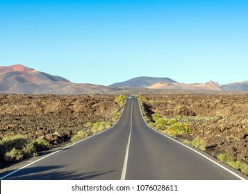 Scenic road and volcanic landscape in Timanfaya National Park. Lanzarote, Canary Islands. Spain