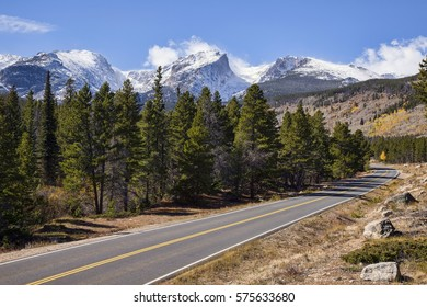 A scenic road winds through Rocky Mountain National Park in Colorado.